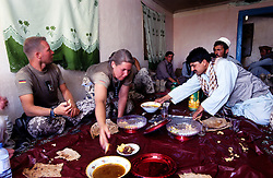 "YAFTAL PAYAN, 31 July 2005..German soldiers/ISAF having some food at Bitha Bala's guest house...They came here to meet the head of the village who, apparently, is not there...Ralph - on the left - says that their duty is to look at the life conditions of the villagers and to report it to the reconstruction team. ..""The aim is to cooordinate the work of all NGOs operating in Afghanistan"" he adds."