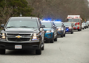 CENTERVILLE - Barnstable community liaison officer Brian Morrison leads a birthday parade of police and fire vehicles as well as friends and family for Coco's 5th birthday on Monday, April 20, 2020.