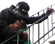 Marquita Brown mourns the loss of her 14-year-old son Davon Ellis as she is comforted by Michael Walker during a memorial earlier today in Oakland. Police say Davon was walking with his friends last Saturday when he was shot on the 3300 block of Brookdale Avenue. Police and paramedics performed CPR on Davon, but he died at a hospital. Police say they don't know what led up to the shooting and no arrests have been made. Oakland police are offering a reward of up to $20,000 for information leading to an arrest.
