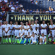ORLANDO, FL - OCTOBER 25: The entire United States women's team watches a dedication video on the screen for retiring players Lauren Holiday and Lori Chalupny after a women's international friendly soccer match between Brazil and the United States at the Orlando Citrus Bowl on October 25, 2015 in Orlando, Florida. The United States won the match 3-1. (Photo by Alex Menendez/Getty Images) *** Local Caption ***