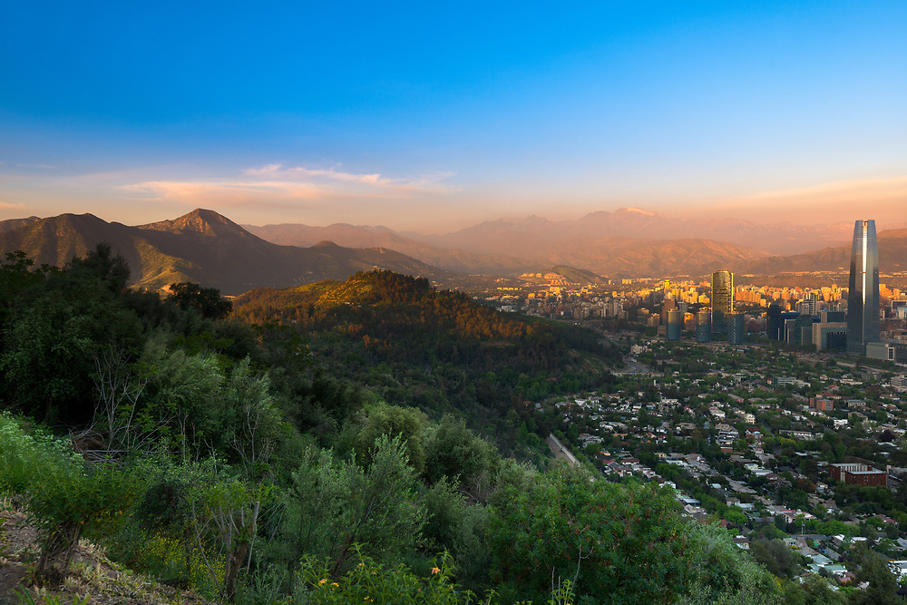 Panoramic view of Santiago with Parquemet Metropolitan park and Cerro Manquehue at sunset, Santiago de Chile, Chile