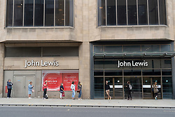 Edinburgh, Scotland, UK. 13 July, 2020, Monday in Scotland saw re-opening of shopping centres after further relaxation of coronavirus lockdown on business. John Lewis & Partners department store opened early at 9.30 am after a long queue had formed outside. Iain Masterton/Alamy Live News