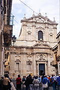 Tour group with guide outside the cathedral church in Lecce, Apulia, Italy in 1999
