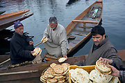 In the vegetable markets not only vegetables are traded but as we know on the occasion of this market other businessmen come together. Here for them famous kasmiri breads are also sold. Srinagar, © Sandipa Malakar.