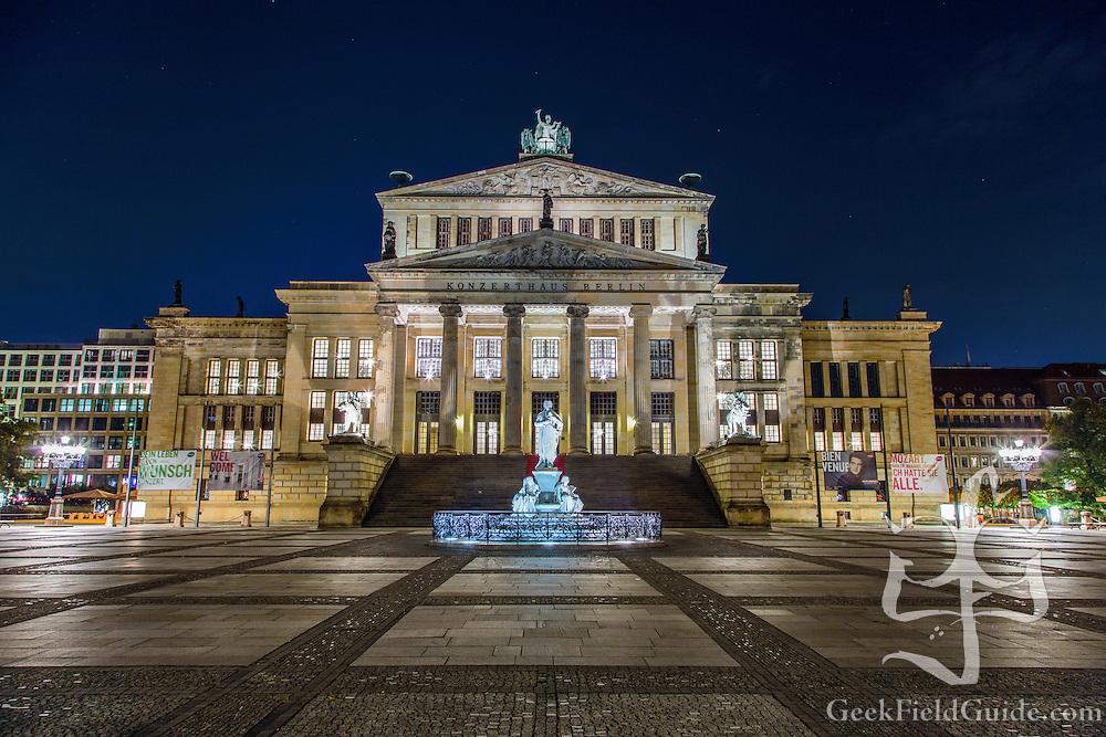 Long-exposure photo of the Berlin Concert hall in the Gendarmenmarkt plaza.