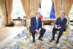 French President Emmanuel Macron and US President Donald Trump attend a meeting at the Elysee Palace in Paris July 13, 2017. Donald Trump arrived in Paris for a 24-hour trip that coincides with France's national day and the 100th anniversary of US involvement in World War I. Photo by eliot Blondet/ABACAPRESS.COM