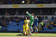 Oxford United goalkeeper Simon Eastwood (1) punches clear during the EFL Sky Bet League 1 match between Oxford United and AFC Wimbledon at the Kassam Stadium, Oxford, England on 13 April 2019.