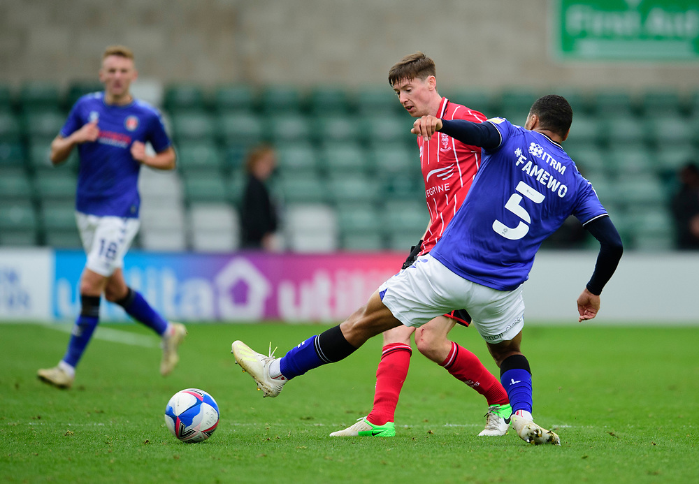 Lincoln City's Conor McGrandles battles with Charlton Athletic's Akin Famewo<br /> <br /> Photographer Andrew Vaughan/CameraSport<br /> <br /> The EFL Sky Bet League One - Lincoln City v Charlton Athletic - Sunday 27th September, 2020 - LNER Stadium - Lincoln<br /> <br /> World Copyright © 2020 CameraSport. All rights reserved. 43 Linden Ave. Countesthorpe. Leicester. England. LE8 5PG - Tel: +44 (0) 116 277 4147 - admin@camerasport.com - www.camerasport.com