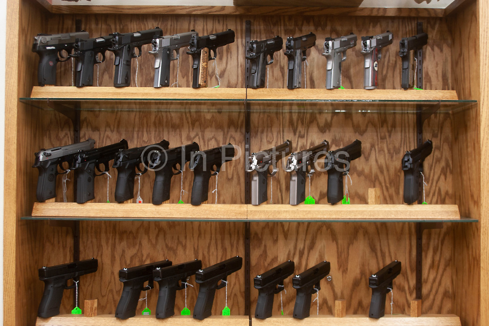 Gun shop in Burlington, near to Minot, North Dakota, United States. Many types of weapons are for sale here from basic shotguns and handguns to military type semi-automatic weapons. Guns and ammunition from this store are used by hunters and for protection.