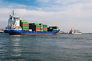 Port Said, Egypt - April 23, 2010: A container ship, the HENRIKE SCHEPERS, enters the Suez Canal in Port Said, Egypt.