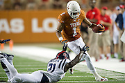 AUSTIN, TX - SEPTEMBER 14: Mike Davis #1 of the Texas Longhorns breaks free against the Mississippi Rebels on September 14, 2013 at Darrell K Royal-Texas Memorial Stadium in Austin, Texas.  (Photo by Cooper Neill/Getty Images) *** Local Caption *** Mike Davis