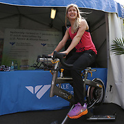 August 16, 2014, New Haven, CT:<br /> Eugenie Bouchard bikes on a spin bike in front of the Yale New Haven Health booth during WTA All-Access Hour on day three of the 2014 Connecticut Open at the Yale University Tennis Center in New Haven, Connecticut Sunday, August 17, 2014.<br /> (Photo by Billie Weiss/Connecticut Open)