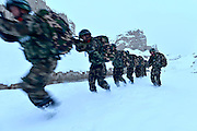 KASHGAR, CHINA - NOVEMBER 22: <br /> Border defense force recruits drill during the long-distance strikes in the snow on November 22, 2016 in Kashgar, Xinjiang Uyghur Autonomous Region of China. 300 border defense force recruits attended a drill including 15 km march on foot, long-distance strikes, basic tactics and search in mountains on the snowy and windy Tuesday in Xinjiang. <br /> ©Exclusivepix Media
