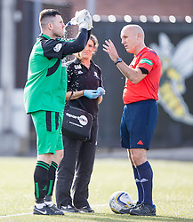 Alloa Athletic's keeper Craig McDowall cleans his injured face.<br /> Alloa Athletic 2 v 1 Hibernian, Scottish Championship game played 30/8/2014 at Alloa Athletic's home ground, Recreation Park, Alloa.