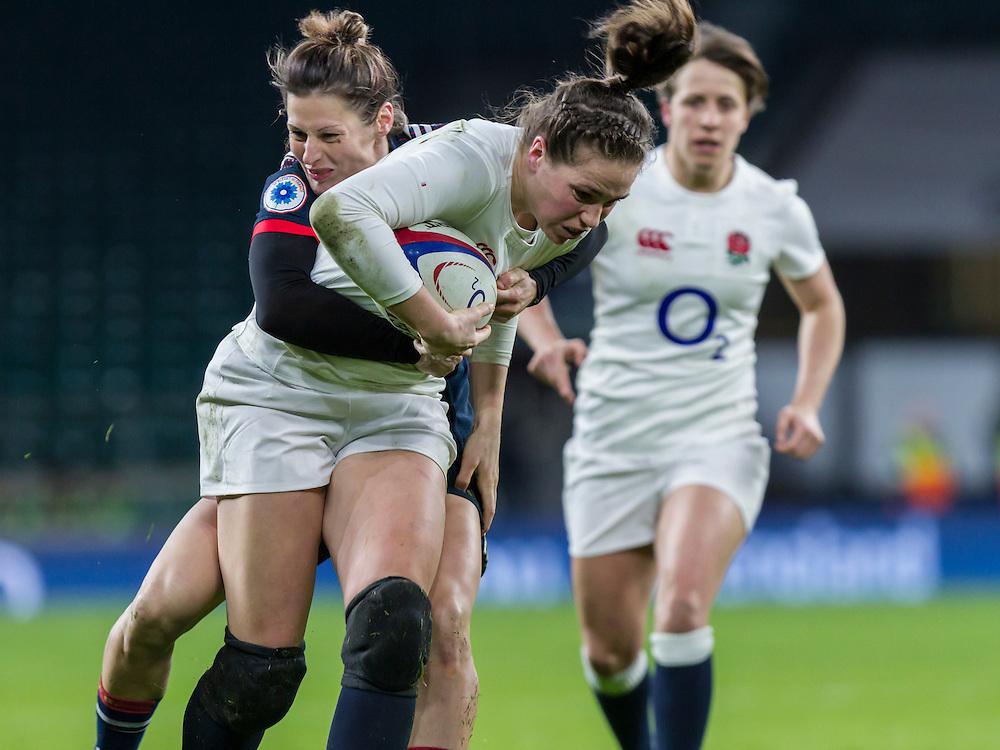 Emily Scarratt tackled, England Women v France Women in a 6 Nations match at Twickenham Stadium, London, England, on 4th February 2017 Final Score 26-13.