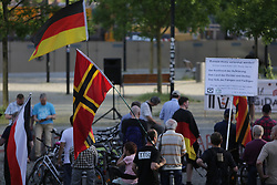 May 29, 2017 - Berlin, Germany - Protester wave a Wirmer flag and a German flag. A handful of right-wing protesters came to their weekly rally in Berlin where they spoke out against foreigners and refugees and specific against the German churches and their pro-refugees policies. The protest is part of the larger PEGIDA movement, that meets regularly in several German cities. (Credit Image: © Michael Debets/Pacific Press via ZUMA Wire)