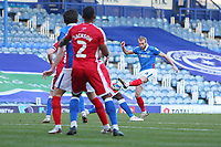 Football - 2020 / 2021 Sky Bet League One - Portsmouth vs. Gillingham - Fratton Park<br /> <br /> Portsmouth's Jack Whatmough has a shot deflected wide during the League One fixture at Fratton Park <br /> <br /> COLORSPORT/SHAUN BOGGUST