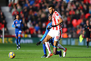 Eric Maxim Choupo-Moting of Stoke City gets his cross in under pressure from Wilfred Ndidi of Leicester City. Premier league match, Stoke City v Leicester City at the Bet365 Stadium in Stoke on Trent, Staffs on Saturday 4th November 2017.<br /> pic by Chris Stading, Andrew Orchard sports photography.