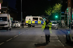 © Licensed to London News Pictures. 26/07/2020. Manchester, UK. Police officers working on Henbury Street. A 17 year old boy has been stabbed to death and three others stabbed causing injuries , in the Moss Side area of South Manchester this evening. Photo credit: Joel Goodman/LNP