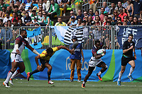 August 11, 2016; Rio de Janeiro, Brazil; USA Men's Eagles Sevens Carlin Isles edges over the Spanish defense during the Men's Rugby Sevens 9th Place Final match on Day 4 of the Rio 2016 Olympic Games at Deodoro Stadium. Photo credit: Abel Barrientes - KLC fotos