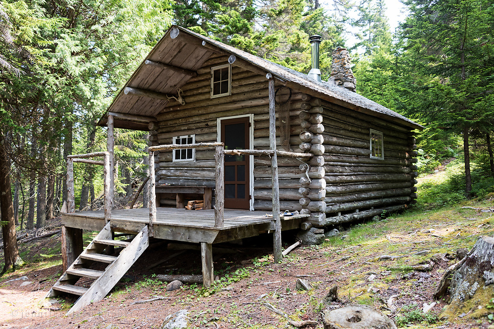 Log cabin in the woods of Acadia National Park on Isle au Haut, Maine, USA
