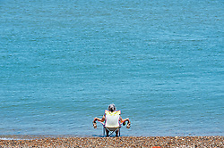 ©Licensed to London News Pictures 20/05/2020  <br /> Minster on sea, UK. This elderly lady has found a quiet spot to relax with her feet in the sea. People enjoying their lockdown freedom with a day by the sea at Minster-on-sea on the Isle of Sheppey in Kent. Today is expected to be the hottest day of the year with temperatures in the South East of the UK to hit around 29C. Photo credit:Grant Falvey/LNP