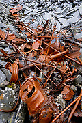 The rusting remains of a vehicle from the slate mining industry lies surrounded by slate waste, on 5th October 2021, in Blaenau Ffestiniog, Gwynedd, Wales. The derelict slate mines around Blaenau Ffestiniog in north Wales were awarded UNESCO World Heritage status in 2021. The industry's heyday was the 1890s when the Welsh slate industry employed approximately 17,000 workers, producing almost 500,000 tonnes of slate a year, around a third of all roofing slate used in the world in the late 19th century. Only 10% of slate was ever of good enough quality and the surrounding mountains now have slate waste and the ruined remains of machinery, workshops and shelters have changed the landscape for square miles.