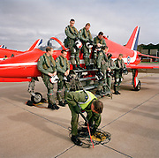 RAF ground crew member of  the 'Red Arrows', Britain's Royal Air Force aerobatic team refuels between training flights.