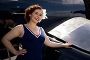 Living history pinup model with F4U-7 Corsair.