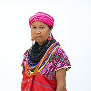 Portrait of a Karen Pwo ethnic minority woman wearing traditional clothing and chewing betel nut at Mae Lay village, Chiang Mai province, Thailand