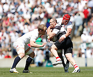 Picture by Andrew Tobin/Tobinators Ltd +44 7710 761829.26/05/2013.Mike Tindall captain of the Barbarians is tackled by Tom Johnson of England (R) during the match between England and the Barbarians at Twickenham Stadium, Twickenham.