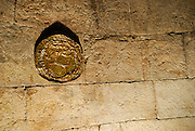 Wall plaque representing coin of Emperor Diocletian's time. Palace of Diocletian, Split, Croatia