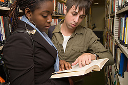 University students looking at books in the College Library,