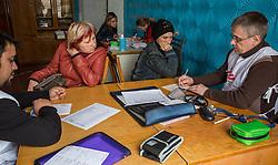 Irina, 21, and her mother Yulia consult doctors Mohsin Mehraj  and Vladislav Khoroshko at the MSF mobile clinic in the village of Gorodishe, near Lugansk.