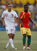 Photo: Steve Bond/Richard Lane Photography.<br />Guinea v Morocco. Africa Cup of Nations. 24/01/2008. Housseine Kharja (L) and Guinea skipper Pascale Feindounou (R) wait for the ball