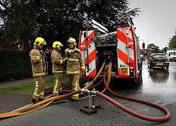 © Licensed to London News Pictures. 01/09/2013. Leyland, UK Fire crews put out the fire. The scene at Leyland St Mary's Catholic Technology College in Leyland, Lancashire as it was devastated by the blaze at 4pm yesterday (1st September 2013), which saw 100ft flames - and was tackled by 125 firefighters and 20 engines. Photo credit : Pat Tack/LNP