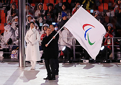 President of the International Paralympic Committee Andrew Parsons waves the Paralympic flag to The Mayor of Beijing Chen Jining during the Closing Ceremony for the PyeongChang 2018 Winter Paralympics in South Korea.