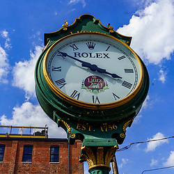 Lititz, PA, USA - August 21, 2020: A large town clock is located at the entrance of the Lititz Springs Park in the downtown area.