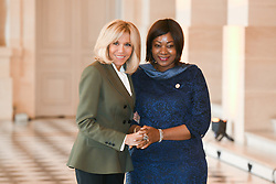 French President's wife Brigitte Macron welcomes Guinean President's wife Djene Kaba as they take part in a spousal event at the Chateau de Versailles in Versailles, near Paris, on November 11, 2018 as part of commemorations marking the 100th anniversary of the 11 November 1918 armistice, ending World War I. Photo By Laurent Zabulon/ABACAPRESS.COM