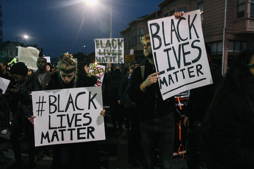 Protesters holding signs in Oakland, CA 2014