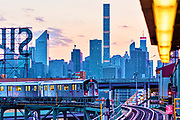 The No. 7 Subway Train at Queens Plaza, Long Island City, Queens, New York, with Manhattan Skyline in the Background, Including the Citicorp Building, 432 Park Avenue and Silvercup Studios Sign.