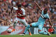 Alex Oxlade-Chamberlain of Arsenal competes with Dimitri Payet of West Ham United. Barclays Premier League, Arsenal v West Ham Utd at the Emirates Stadium in London on Sunday 9th August 2015.<br /> pic by John Patrick Fletcher, Andrew Orchard sports photography.