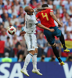 MOSCOW, July 1, 2018  Nacho (R) of Spain competes for a header with Fedor Kudriashov of Russia during the 2018 FIFA World Cup round of 16 match between Spain and Russia in Moscow, Russia, July 1, 2018. (Credit Image: © Yang Lei/Xinhua via ZUMA Wire)
