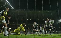 Photo: Andrew Unwin.<br /> Newcastle United v Fenerbahce. UEFA Cup. 19/10/2006.<br /> Fenerbahce's goalkeeper, Rustu Recber (#34), cannot stop Newcastle's Antoine Sibierski (L, hidden) from scoring.