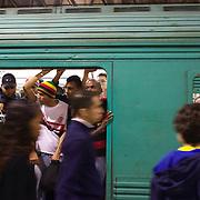 Fans pack into a train after the  Flamengo V  Fluminense, Futebol Brasileirao  League match at Estadio Olímpico Joao Havelange, Rio de Janeiro, The classic Rio derby match ended in a 3-3 draw. Rio de Janeiro,  Brazil. 19th September 2010. Photo Tim Clayton.
