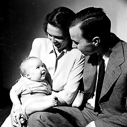 H075-02  George H. and Barbara Bush with their son, George W., in New Haven, CT,<br /> April 1947.<br /> Photo Credit:  George Bush Presidential Library