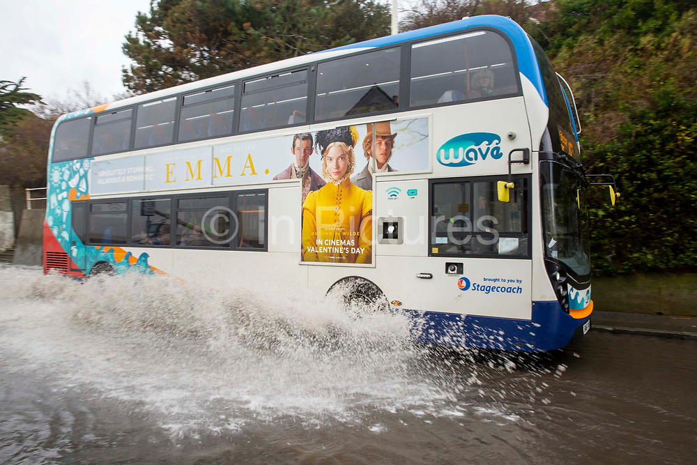 A stagecoach local bus drives  down the A259 between Folkestone and Hythe which is flooded at Sandgate, Kent on the south coast of England, as Storm Ciara continues to sweep over the country on February 10th 2020 in Folkestone, United Kingdom. Amber weather warnings were put into place by the MET office as gusts of up to 90mph and heavy rain swept across the UK. An amber warning from the MET office expects a powerful storm that will disrupt air, rail and sea links travel, cancel sports events, cut electrical power and damage property.