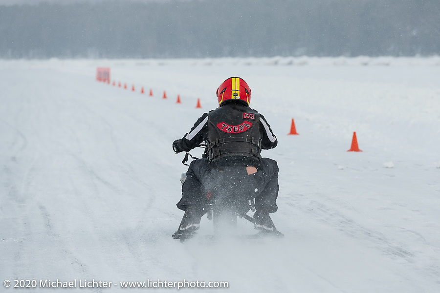 A unimotocycle races down the short qualifying trace at the Baikal Mile Ice Speed Festival. Maksimiha, Siberia, Russia. Thursday, February 27, 2020. Photography ©2020 Michael Lichter.