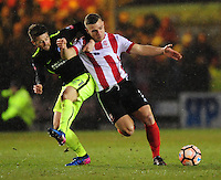 Lincoln City's Jack Muldoon shields the ball from Brighton & Hove Albion's Oliver Norwood<br /> <br /> Photographer Chris Vaughan/CameraSport<br /> <br /> Emirates FA Cup Fourth Round - Lincoln City v Brighton & Hove Albion - Saturday 28th January 2017 - Sincil Bank - Lincoln<br />  <br /> World Copyright © 2017 CameraSport. All rights reserved. 43 Linden Ave. Countesthorpe. Leicester. England. LE8 5PG - Tel: +44 (0) 116 277 4147 - admin@camerasport.com - www.camerasport.com