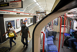 © Licensed to London News Pictures. 23/04/2020. London, UK. A central Lone tube pulls into Oxford Circus during evening rush hour. Transport for London are furloughing a third of their staff as demand for the network falls drastically during the Coronavirus lockdown.  Photo credit: Guilhem Baker/LNP
